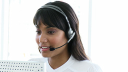 Pretty business woman working in a call centre Footage