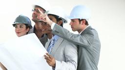 Confident architects studying blueprints Footage