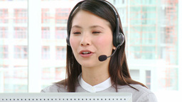 Asian businesswoman with headset on Footage