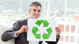 Positive businessman showing the concept of recycl Footage
