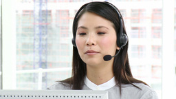 Asian executive with headset on Footage