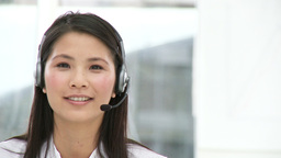 Asian customer agent with headset on Footage
