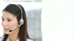 Attractive businesswoman with headset on Footage