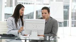 Two concentrated colleagues working at a computer Footage