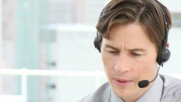 Attractive businessman with headset on Footage