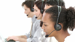 Competitive businesspeople working in a call cente Footage