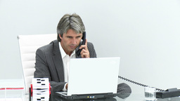 Serious businessman talking on phone Footage