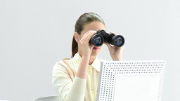 Elegant businesswoman looking through binoculars Footage
