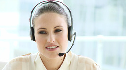 Female executive with headset on Footage