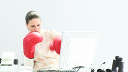 Confident businesswoman wearing boxing gloves Footage