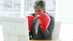 Angry businessman wearing boxing gloves Footage