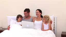 Adorable family surfing together on the web Stock Video Footage