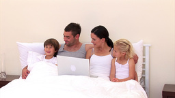 Adorable family surfing together on the web Animation
