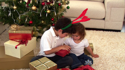 Montage of two children opening their present Animation
