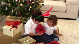 Animation of two children opening their present Animation