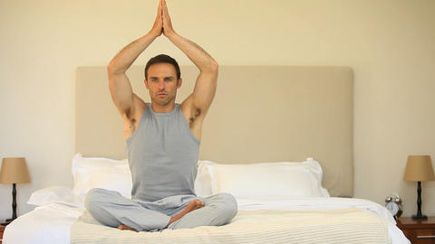 Man doing yoga on the bed Footage