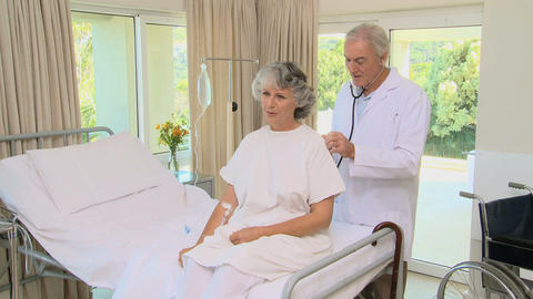 Doctor listening to the breathing of a patient Footage