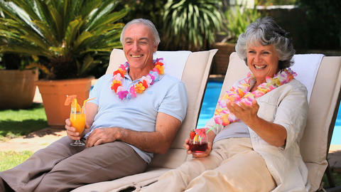 Old couple relaxing on deckchairs Footage