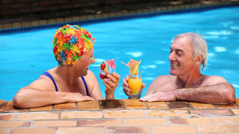 Seniors toasting with cocktails in the pool Footage