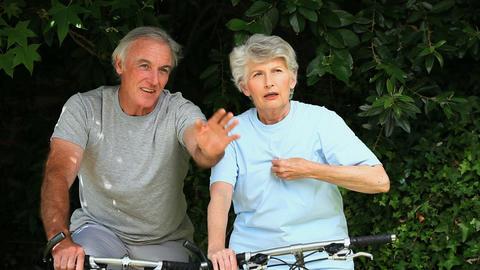 Elderly couple having a bike ride Footage
