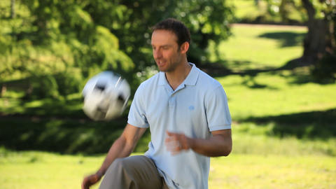 Man juggling with a soccer ball Footage