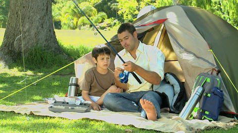 Father teaching the use of the fishing rod to his  Footage