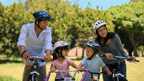 Cute family biking together Footage