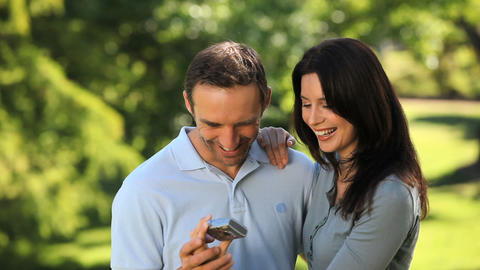 Couple taking photo of themselves Footage