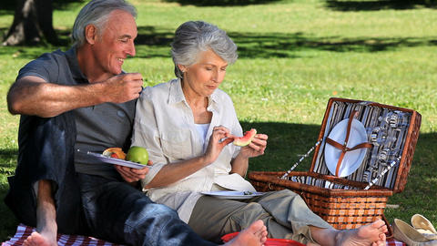 Elderly woman feasting at picnic with her old husb Footage