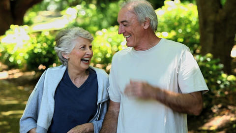 Elderly couple taking a break after running Footage