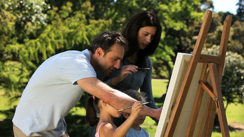 Parents and children painting a canvas Footage