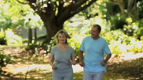 Elderly couple running Footage