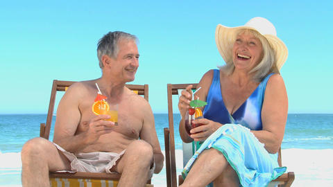 Elderly couple toasting with cocktails Footage