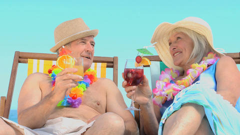 Mature couple toasting with cocktails Footage