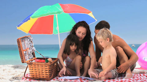 Family having a picnic on the beach Footage