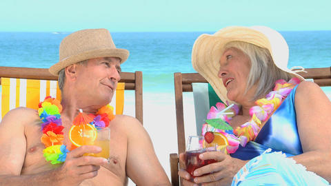 Aged couple toasting with cocktails Footage