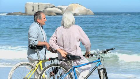 Elderly taking a break after a ride bike Footage