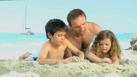 Man and his childs building a sand castle Footage