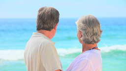 Mature couple looking at the sea Footage