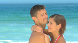 Cute couple hugging at the edge of the sea Footage