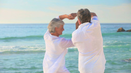 Mature couple dancing on a beach Footage
