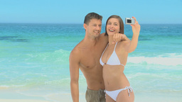 Sweet couple taking pictures and having fun Footage