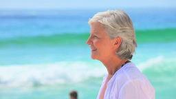 Elderly woman looking far away and smiling Footage