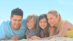 Cute family lying on a beach Footage