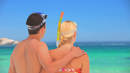 Cute couple wearing snorkels and masks Footage