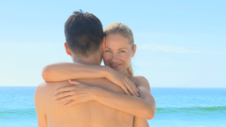 Sweet couple hugging on a beach Footage