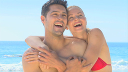 Happy couple hugging on a beach Footage