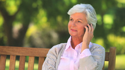 Mature woman having a phone conversation Footage