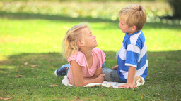Two children talking together Footage