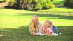 Young woman talking with her daughter Footage